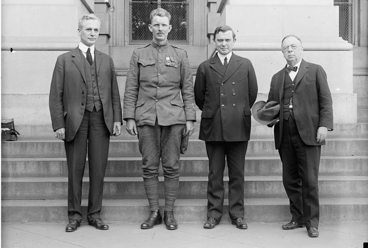 Pictured, left to right, Representative Cordell Hull, Sergeant Alvin C. York, Senator Kenneth McKellar, and Senator George E. Chamberlain.