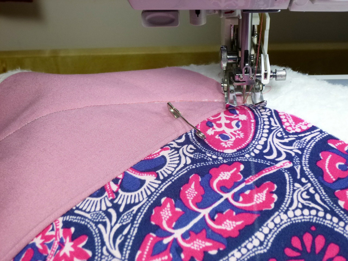 Quilted squares being machine stitched.