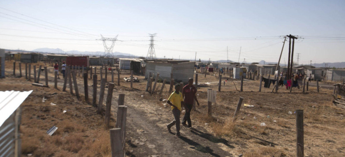 Ramshackle Hovel Where Miniers Live-Cyril Ramaphosa is one of he Shareholders on some mine some of these miners on strike in.