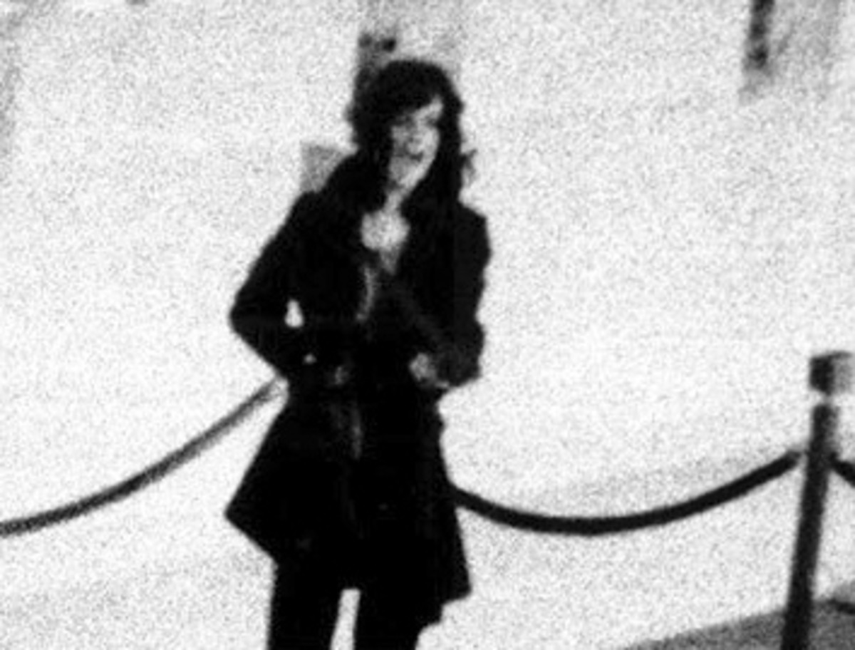 Patricia Hearst yelling out commands to bank customers held at gunpoint during a San Francisco bank robbery.