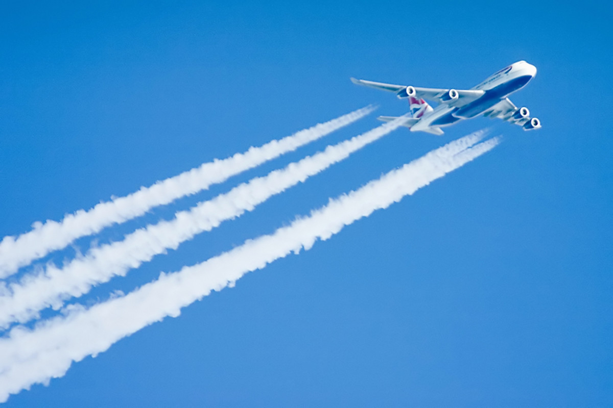 A Four-engined Boeing 747 with contrails. Contrails are produced by condensation of exhaust gases in the cold thin air. But this contrail contain also poisonous gases like NOx, HOx, COx, SOx and organics, formed during the combustion of kerosene.
