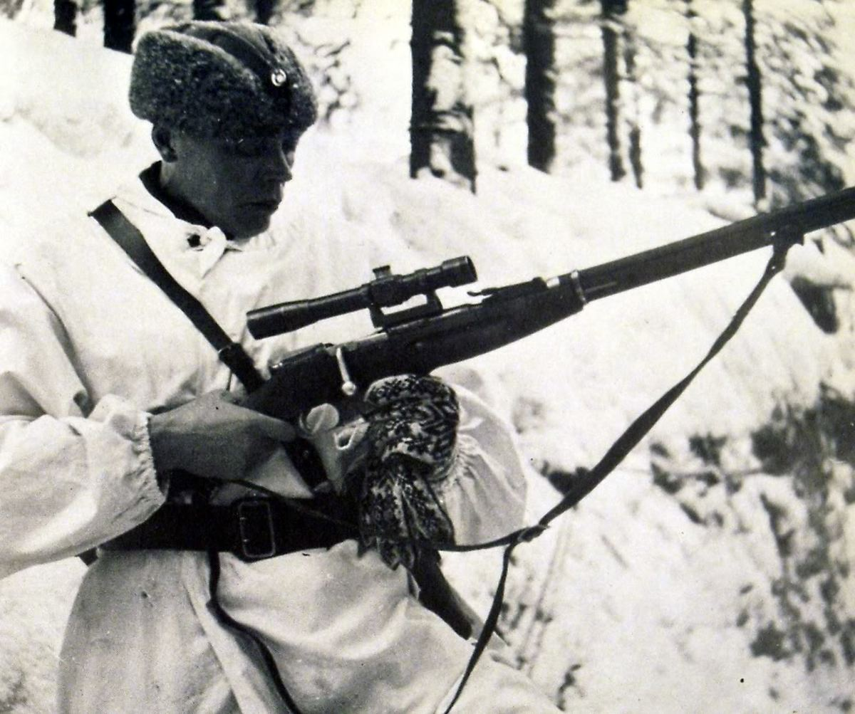 A Finnish Officer Inspecting A Captured Russian Rifle