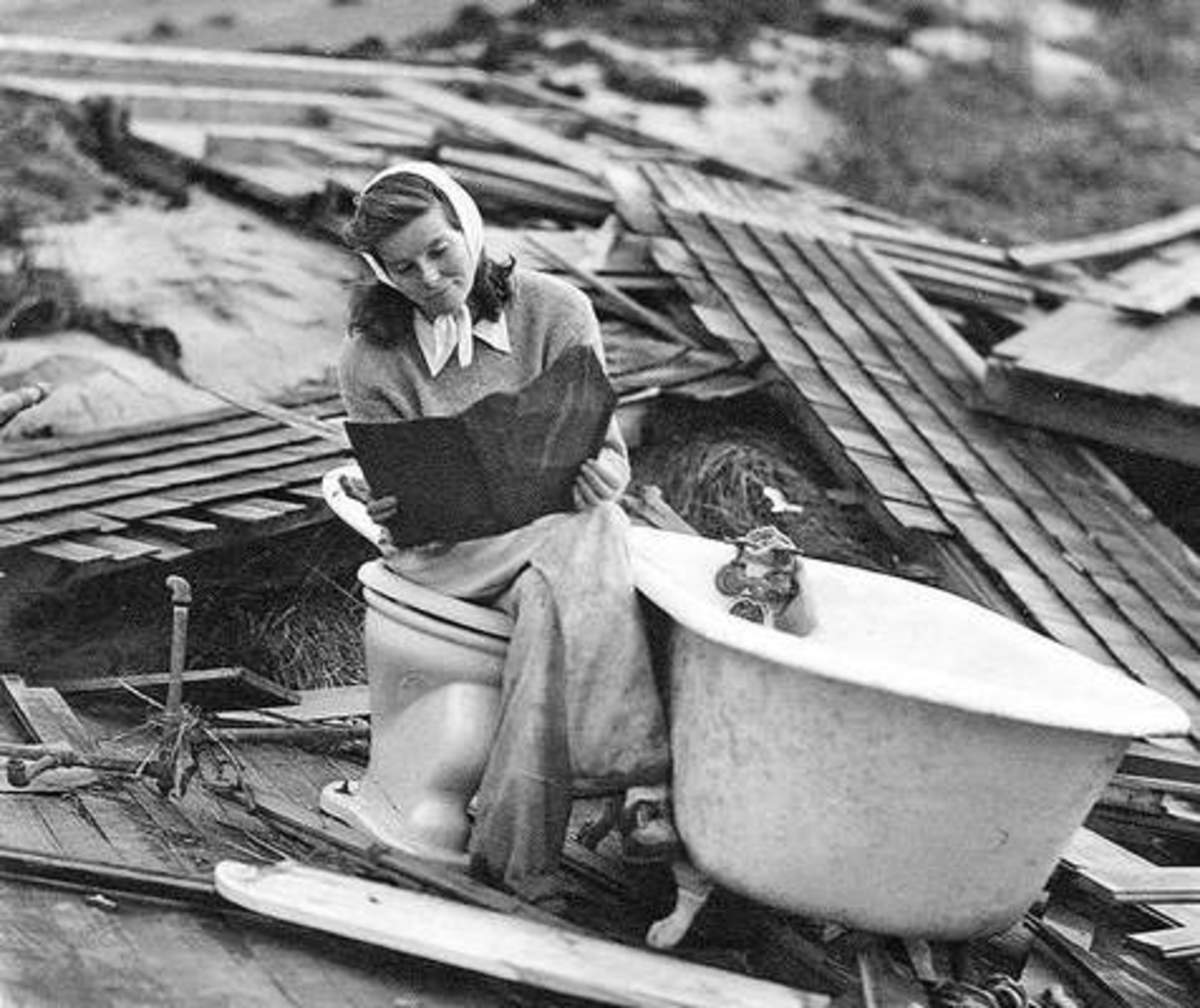 Katharine Hepburn searching through the debris of her Fenwick home after the Hurricane of 1938.
