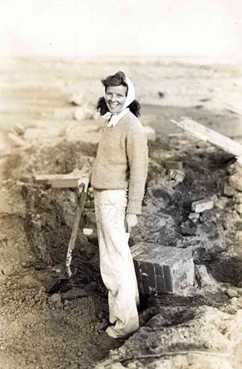 Hepburn searching through debris of her family's summer cottage after the hurricane of 1938.
