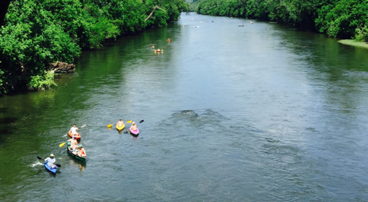 Kayaks and Canoes on a lazy day float down the James River at Percival's Island