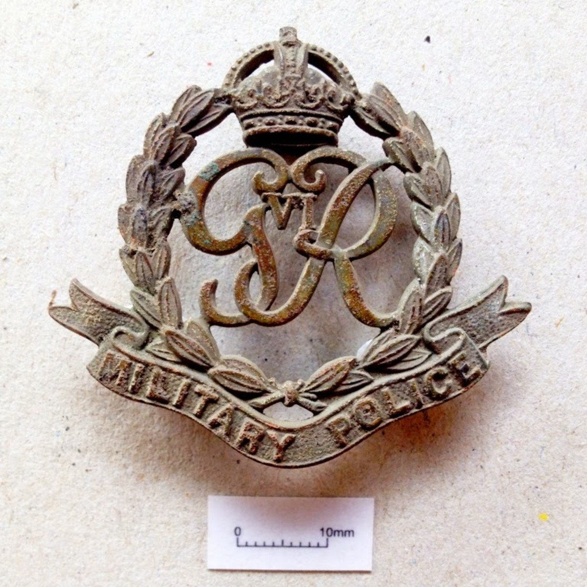 A Military Police cap badge, dated from between 1936-46.