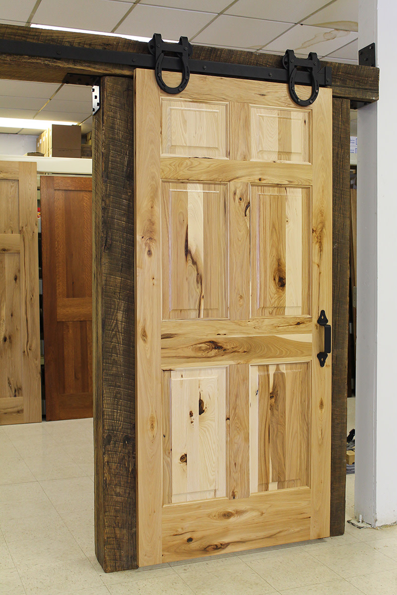 Raised Panel Rustic Door Example with Horseshoe Trolley