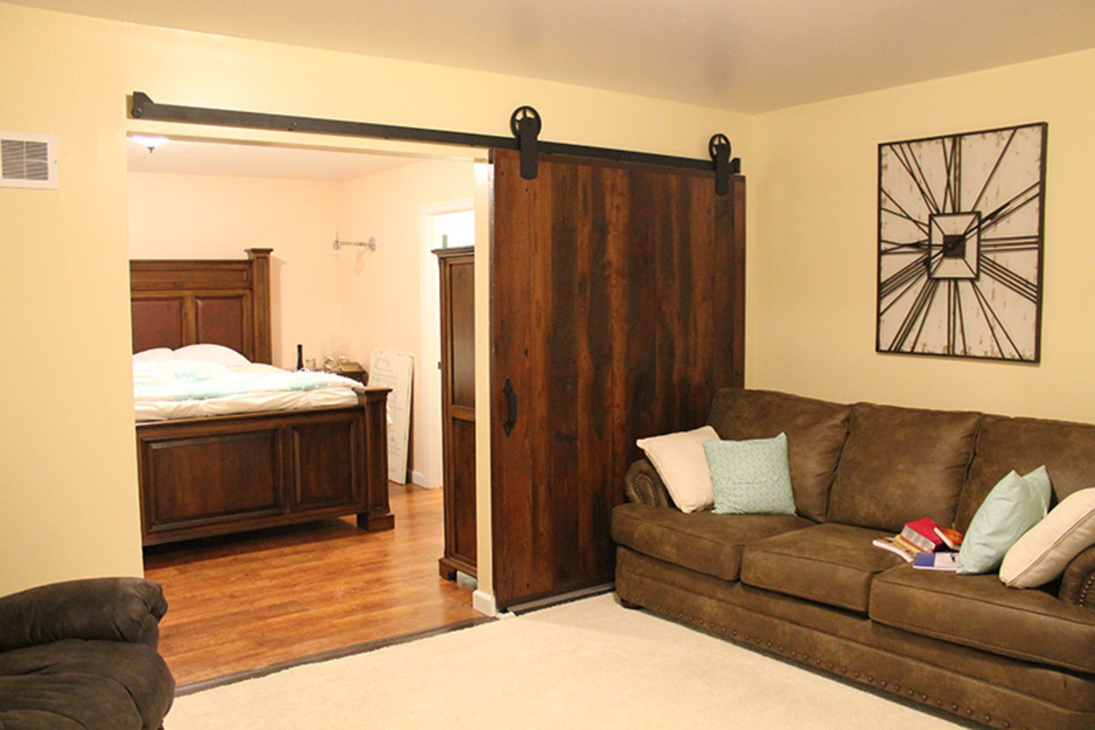 Use barn style sliding doors to enhance decor, save space