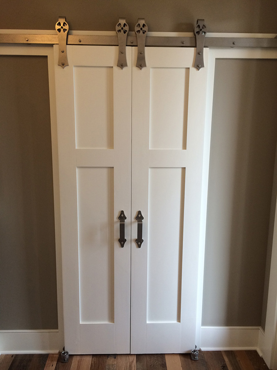 Closet, bath, or pantry door example featured with the Strap Style Hardware in Nickle.
