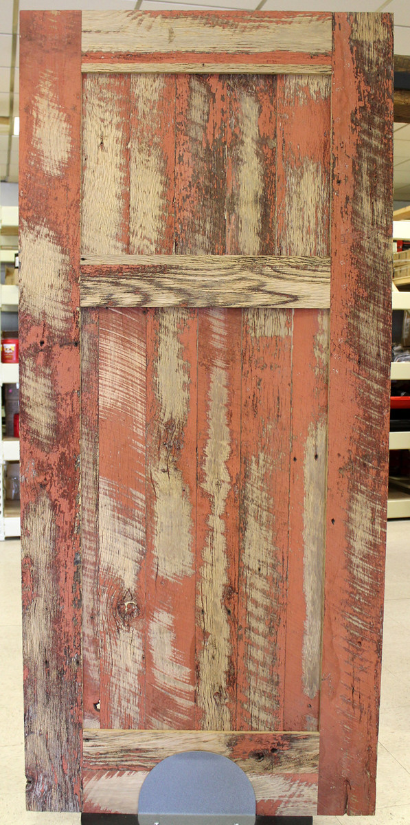 A reclaimed rustic barn door