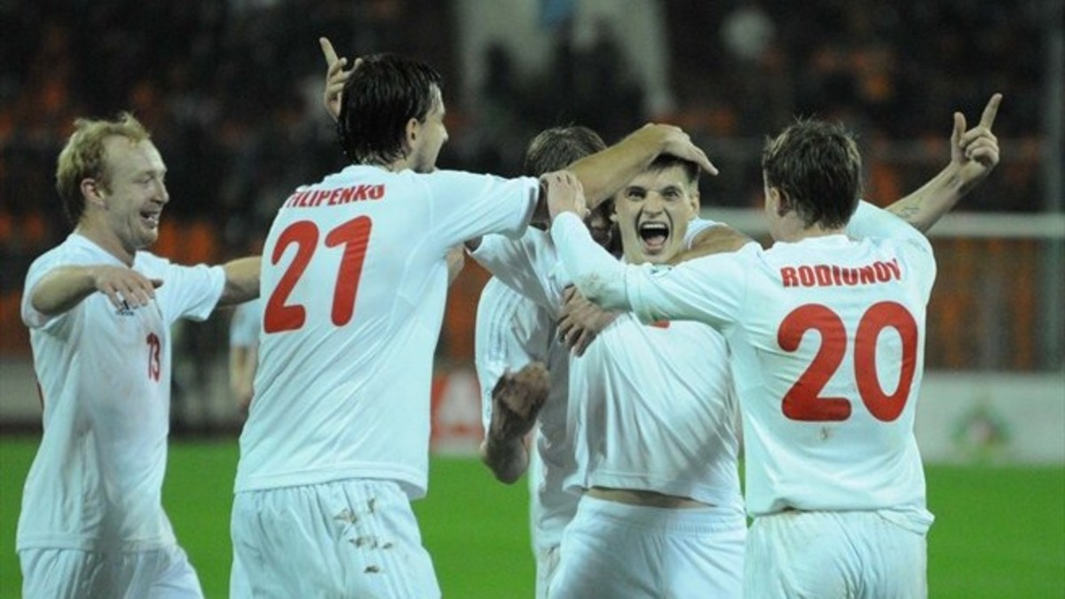 Yahor Filipenko (21) and Vitali Rodionov (20) celebrate with Stanislav Drahun during a 2014 World Cup match in October 2012.