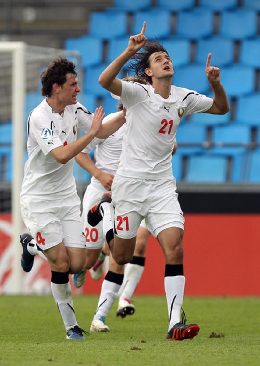 Syarhey Palitsevich (4) celebrates with Egor Filipenko (21) in Belarus's match against the Czech Republic on June 24, 2011. Filipenko scored the winning goal to send the Czech Republic to the Summer Olympics.