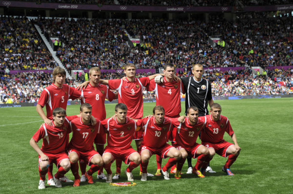 Belarus's starting lineup poses ahead of its match against Brazil at Old Trafford in Manchester, England.