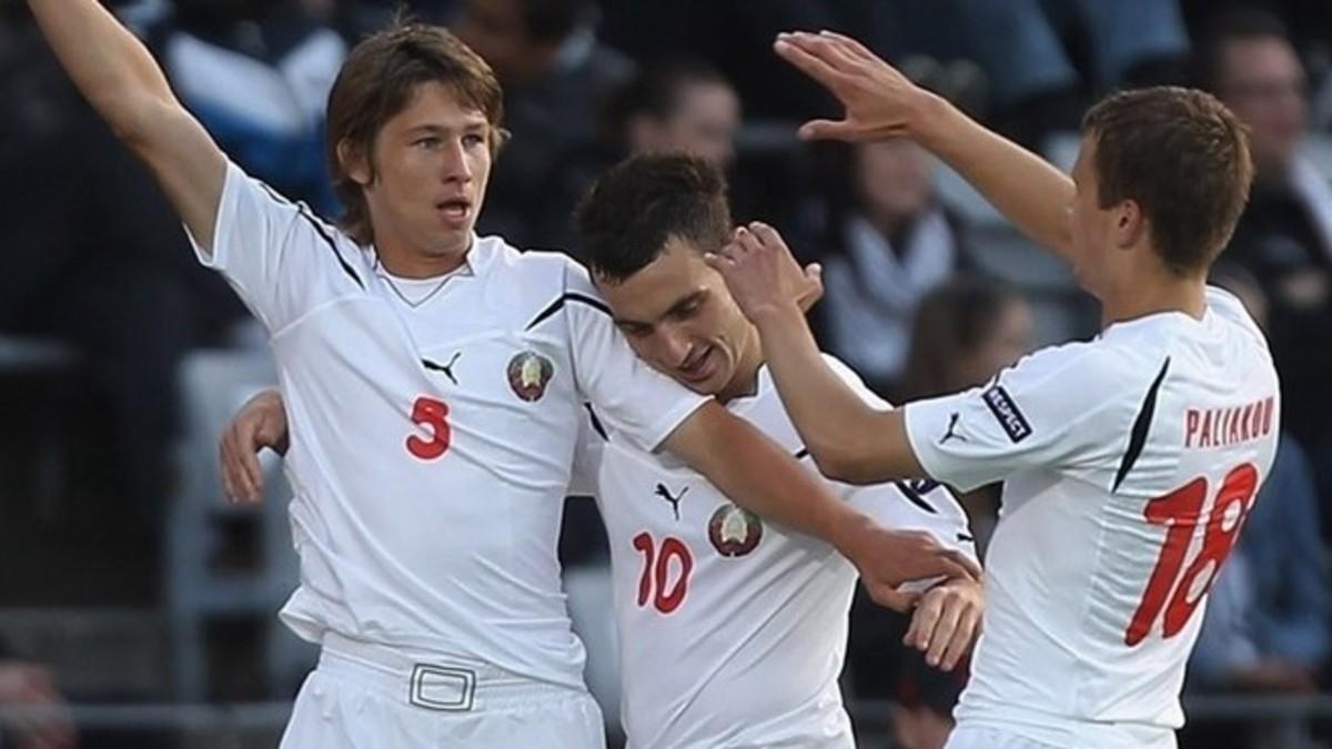 Dzmitry Baga (5) celebrates with Aliaksandr Perepechko (10) and Denis Polyakov (18) after Baga scored a goal against hosts Denmark in Aarhus.