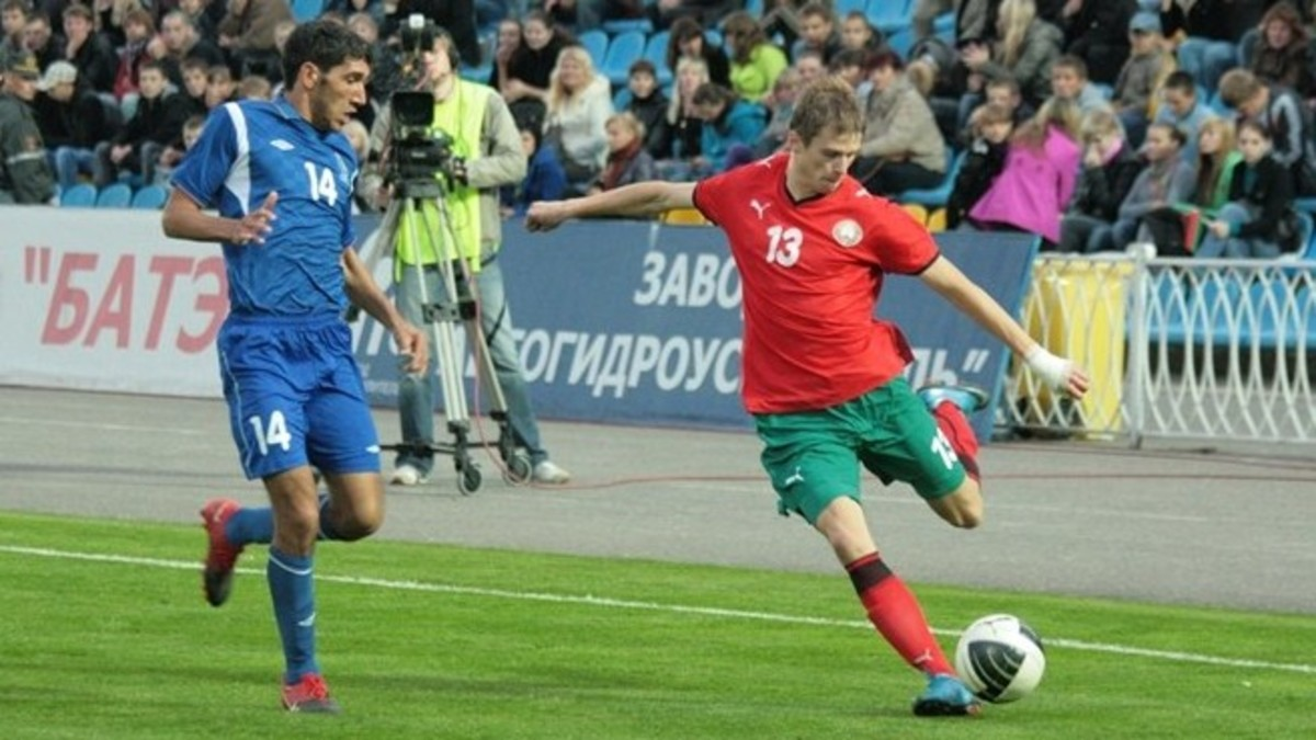 Belarus's Pavel Nekhaychik (14) in action against Bakhtiyar Soltanov and Azerbaijan in a qualifying match in Minsk, Belarus. Nekhaychik scored the only goal of the match to send Belarus to the UEFA U-21 playoffs.