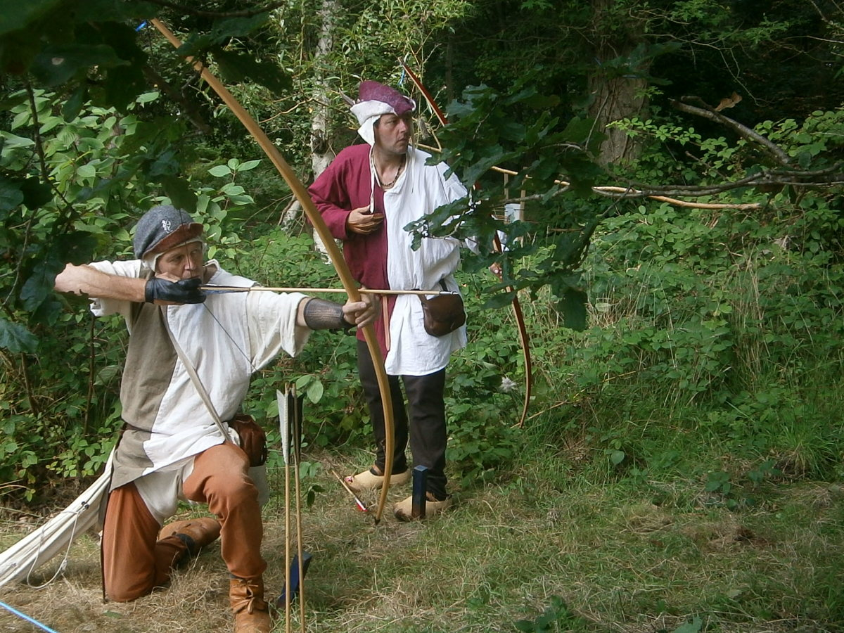 Members of the Dutch Warbow Society at play on the grounds of Herstmonceux Castle in East Sussex