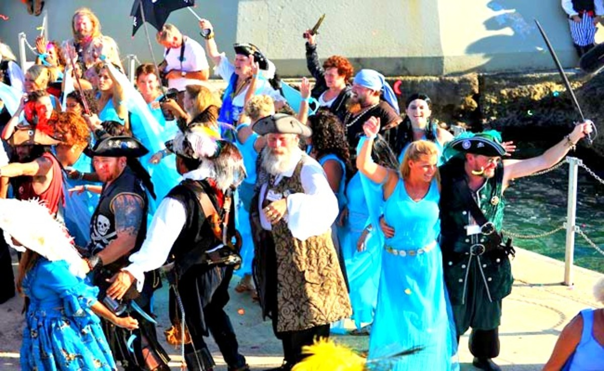 Marauders line the streets or join in the parade, dress in their pirate or wenches garb.