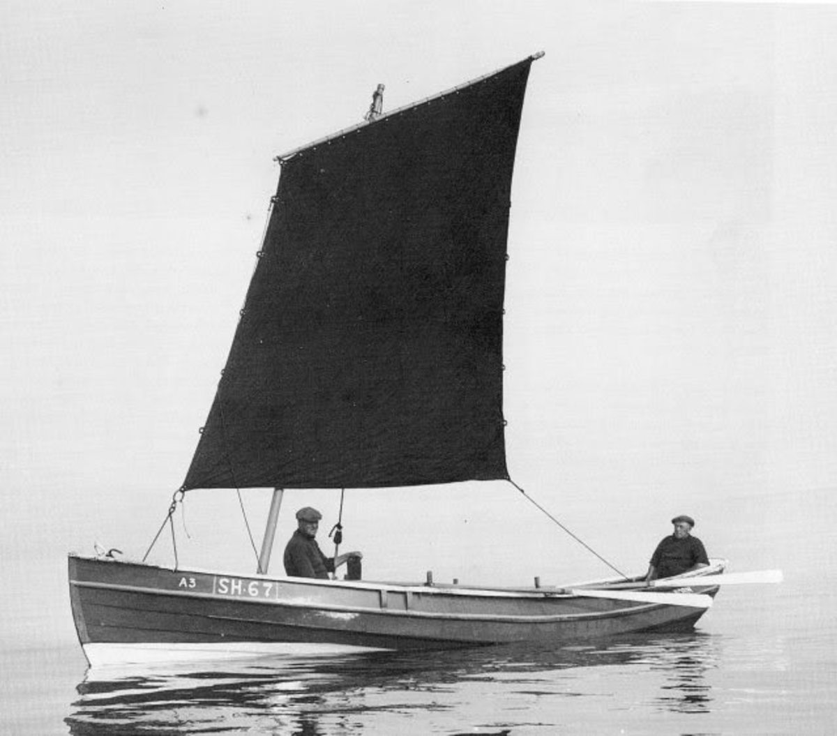 Early view of a coble under sail. These vessels were engine powered from post-WWII years