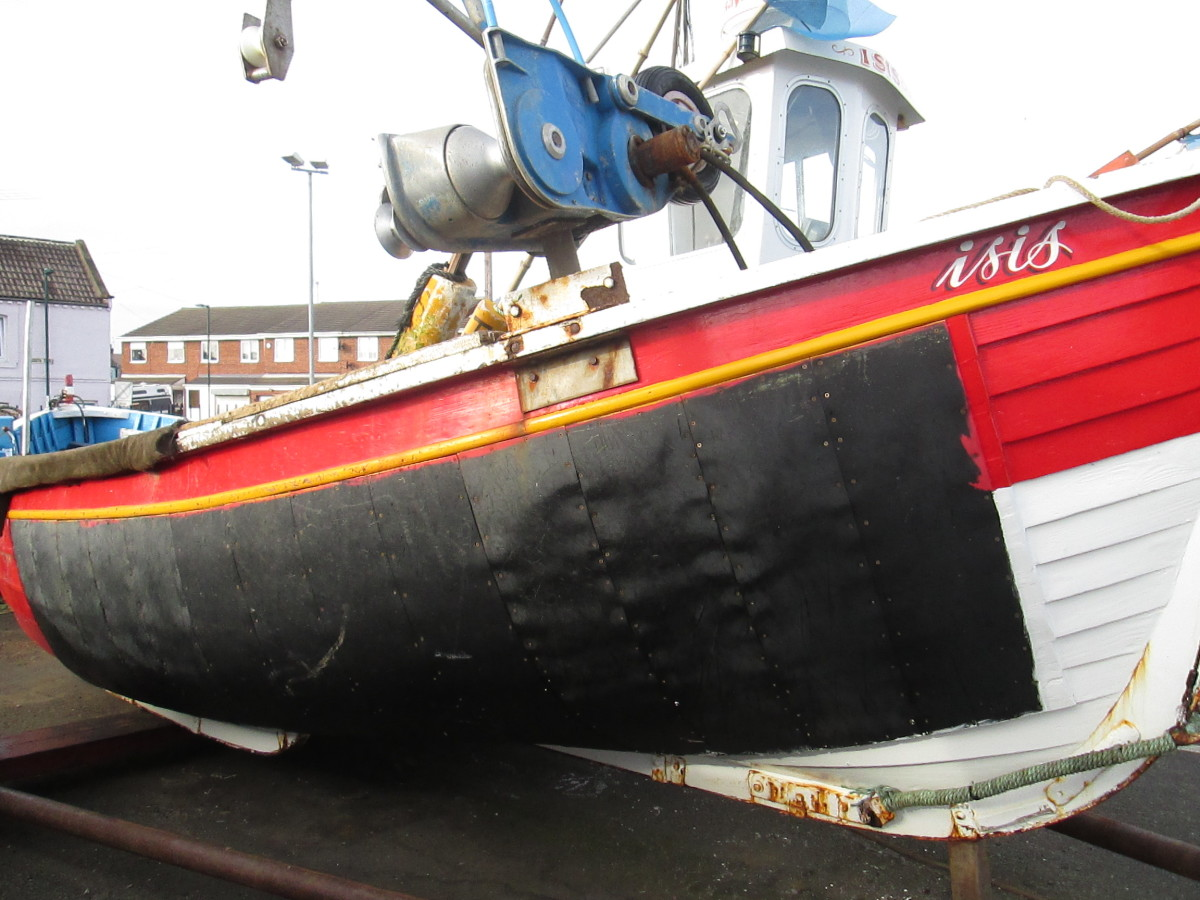 A much patched up Coble with cab and net winch on Fisherman's Square, Redcar (off Lord Street, behind High Street East)