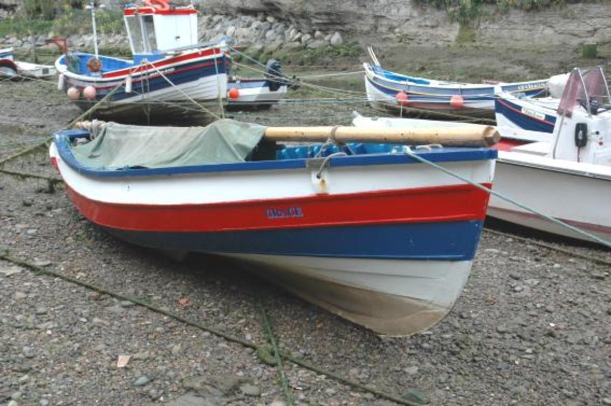 Yorkshire coble in the creek at Staithes, low tide  - the vessel's 'heritage' is shown in the sleek lines of its prow and 'waistline'