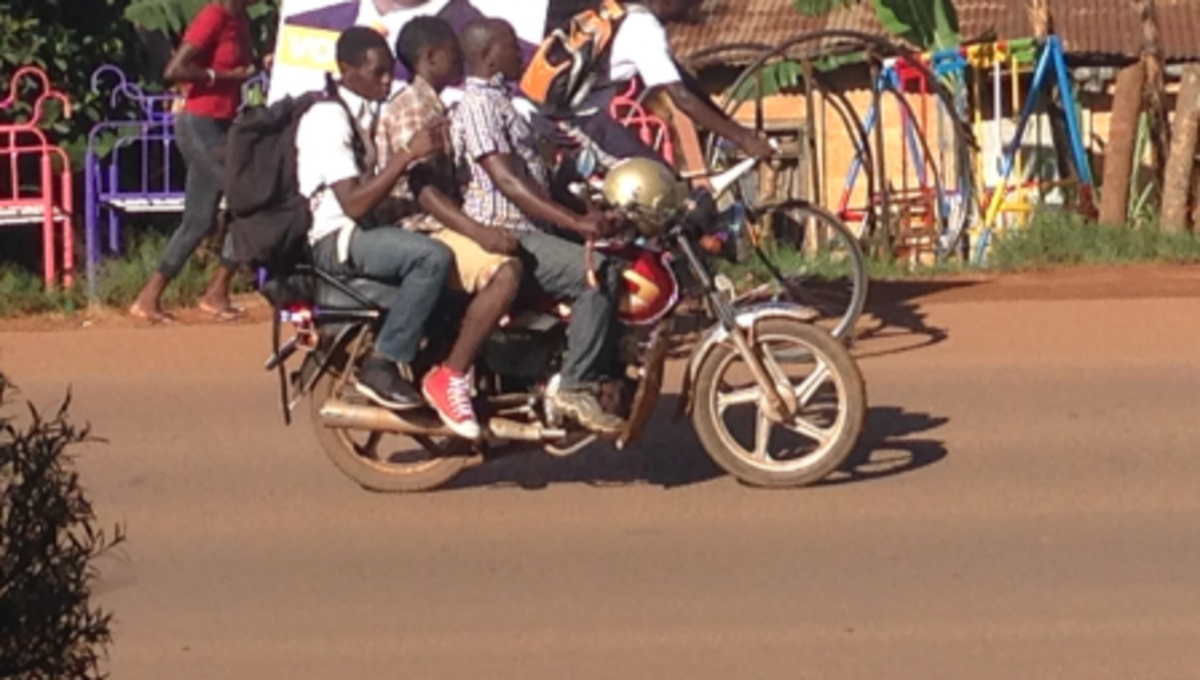 Ugandan people use bodabodas to get around quickly