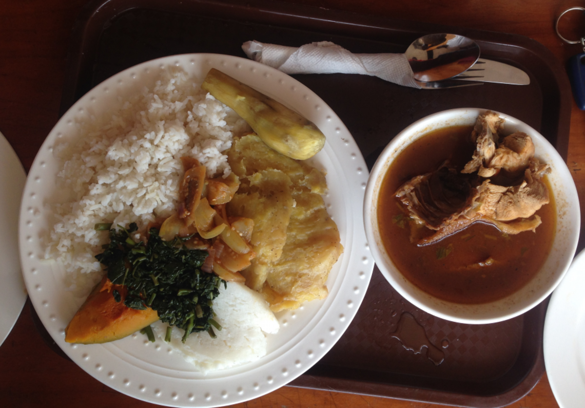 A serving of matooke, posho and rice, and chicken stew