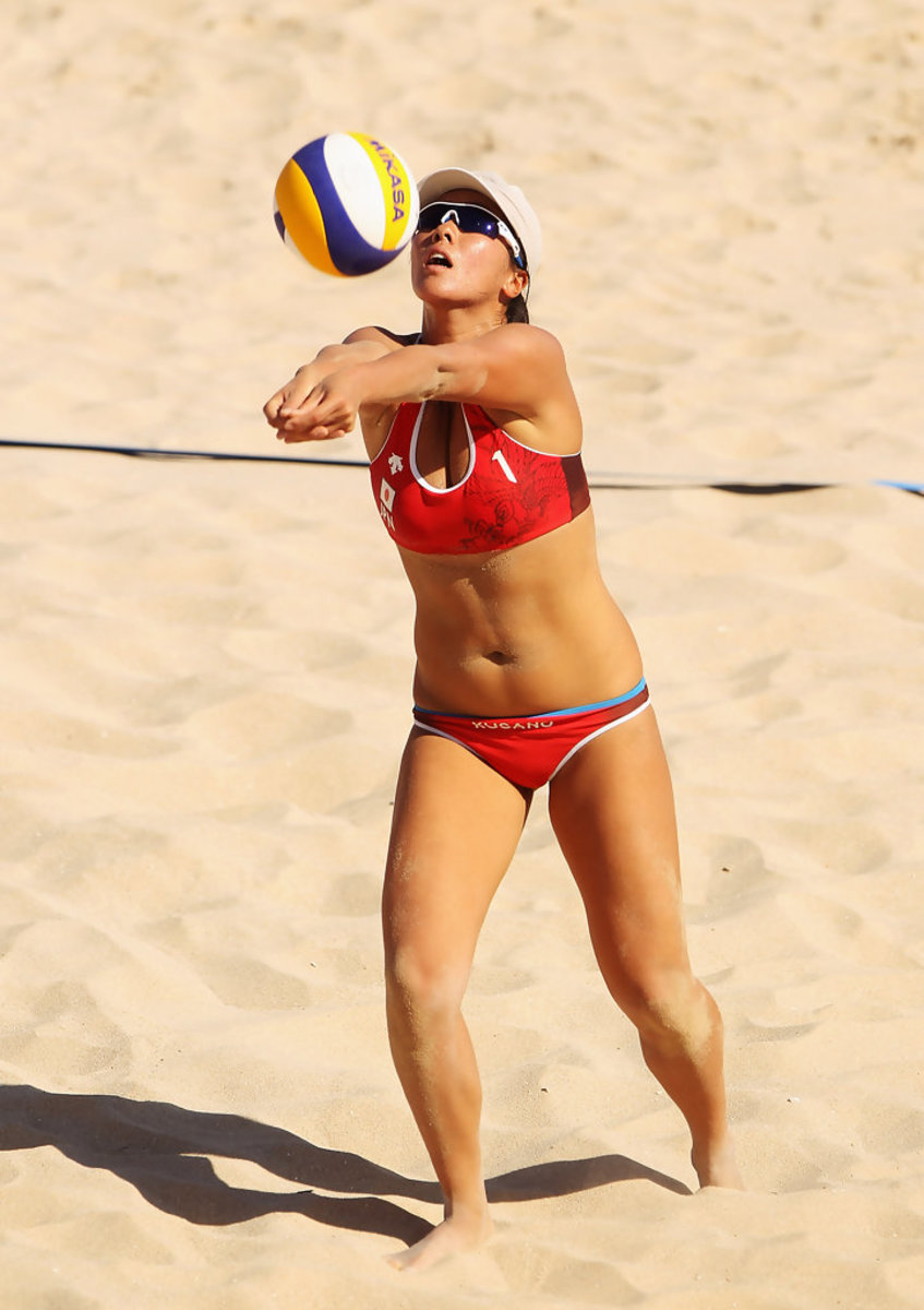 Volleyball player Ayumi Kusano bumps the ball during a match in Bali, Indonesia in 2008.