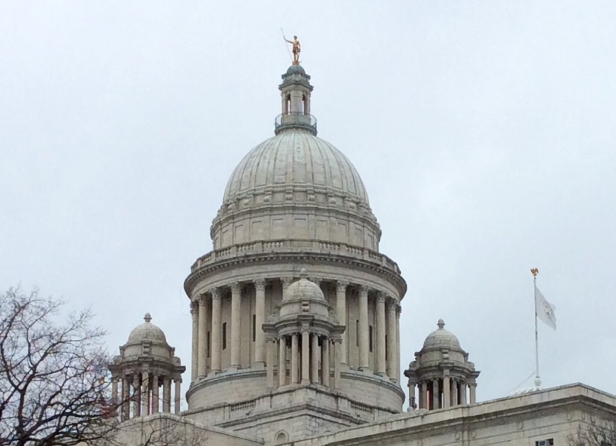 Independent Man atop the State House