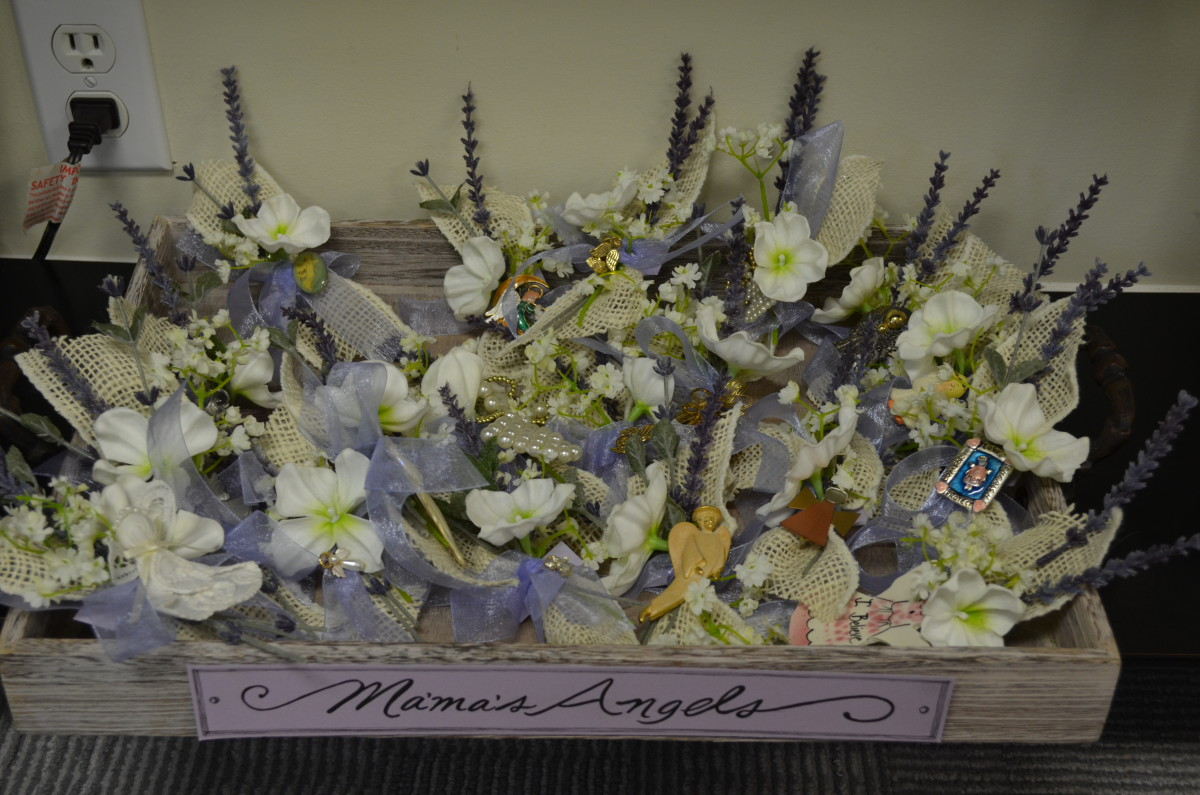 My mother loved angels so we took her pins and made corsages out of them as a keepsake for each family member.