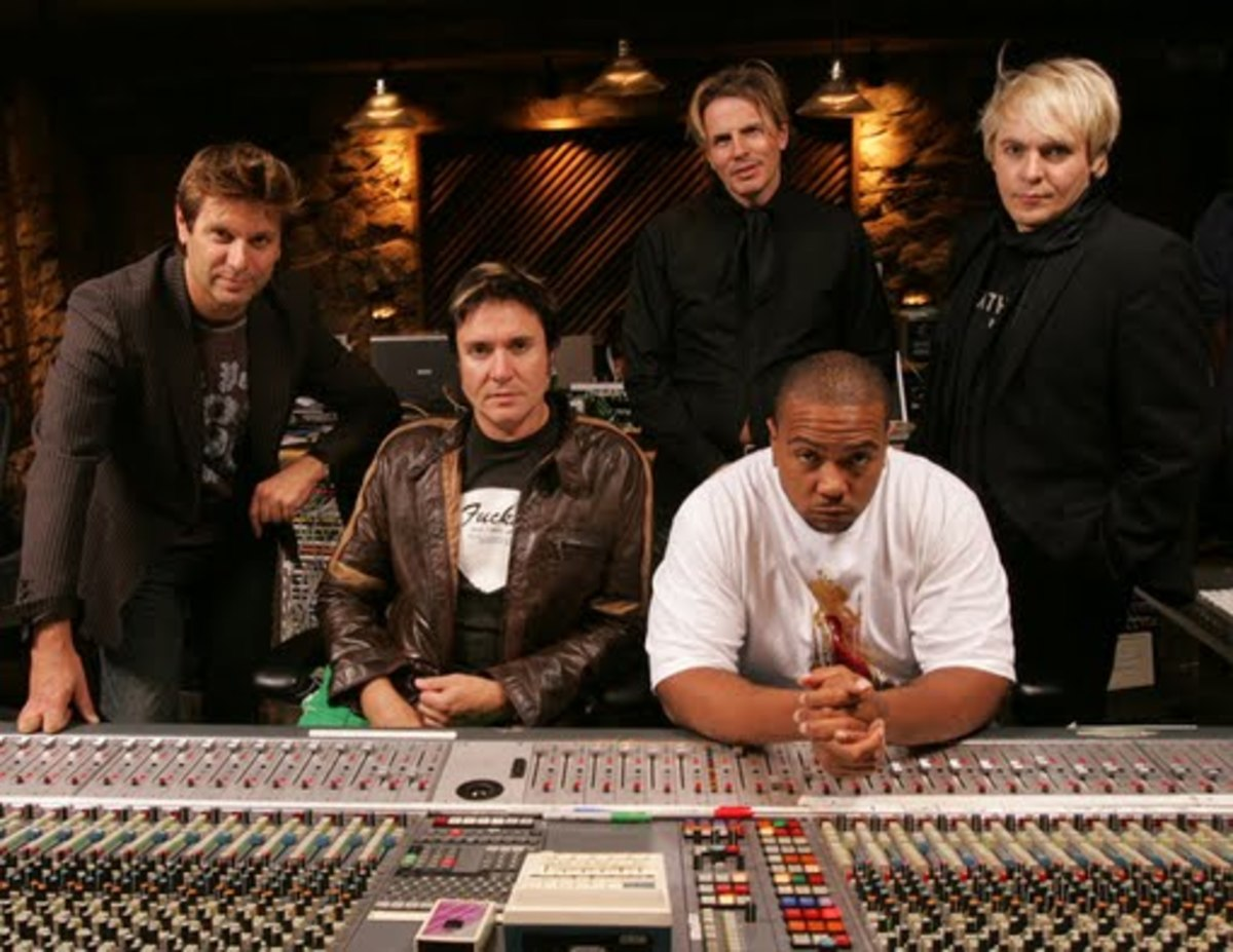 The band with producer Timbaland in the studio