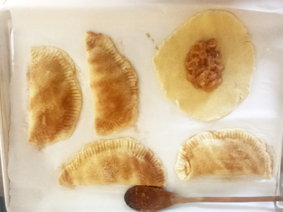 Fill the empanadas with filling and fold.