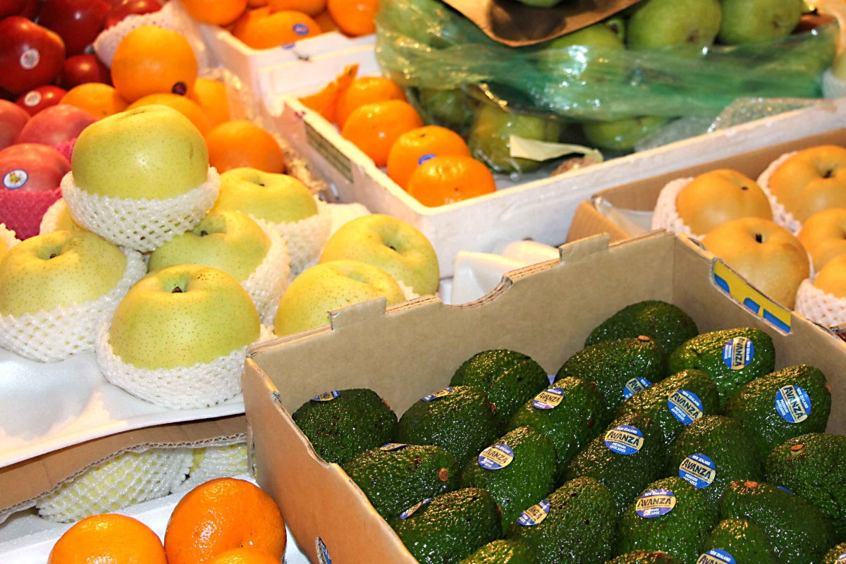 Familiar fruits on sale, including apples, oranges and avocados