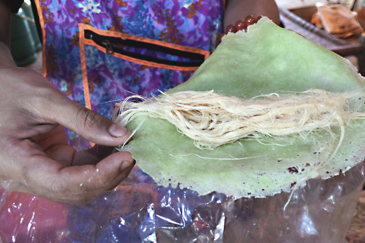 The 'roti saimai' prior to wrapping. Pandanus leaf extract provides the colouring