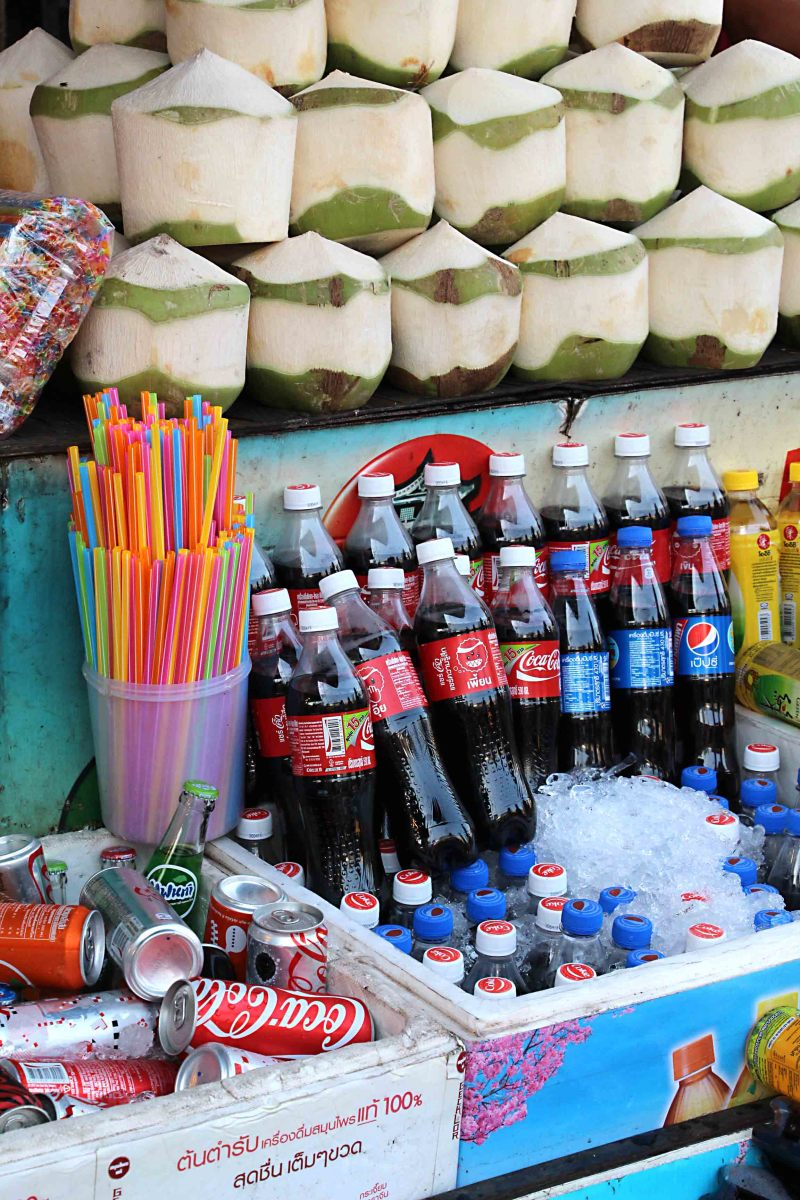 Drinks, Western and traditional. Behind the bottled water and the Coca Cola are the more authentically Thai coconuts