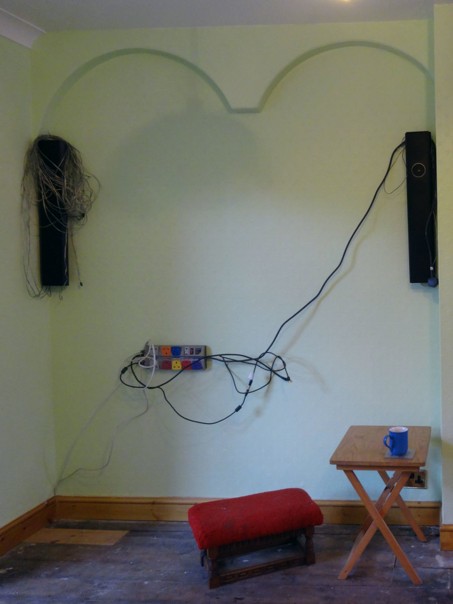 Speaker wires concealed by plaster coving and TV extension socket fixed to wall
