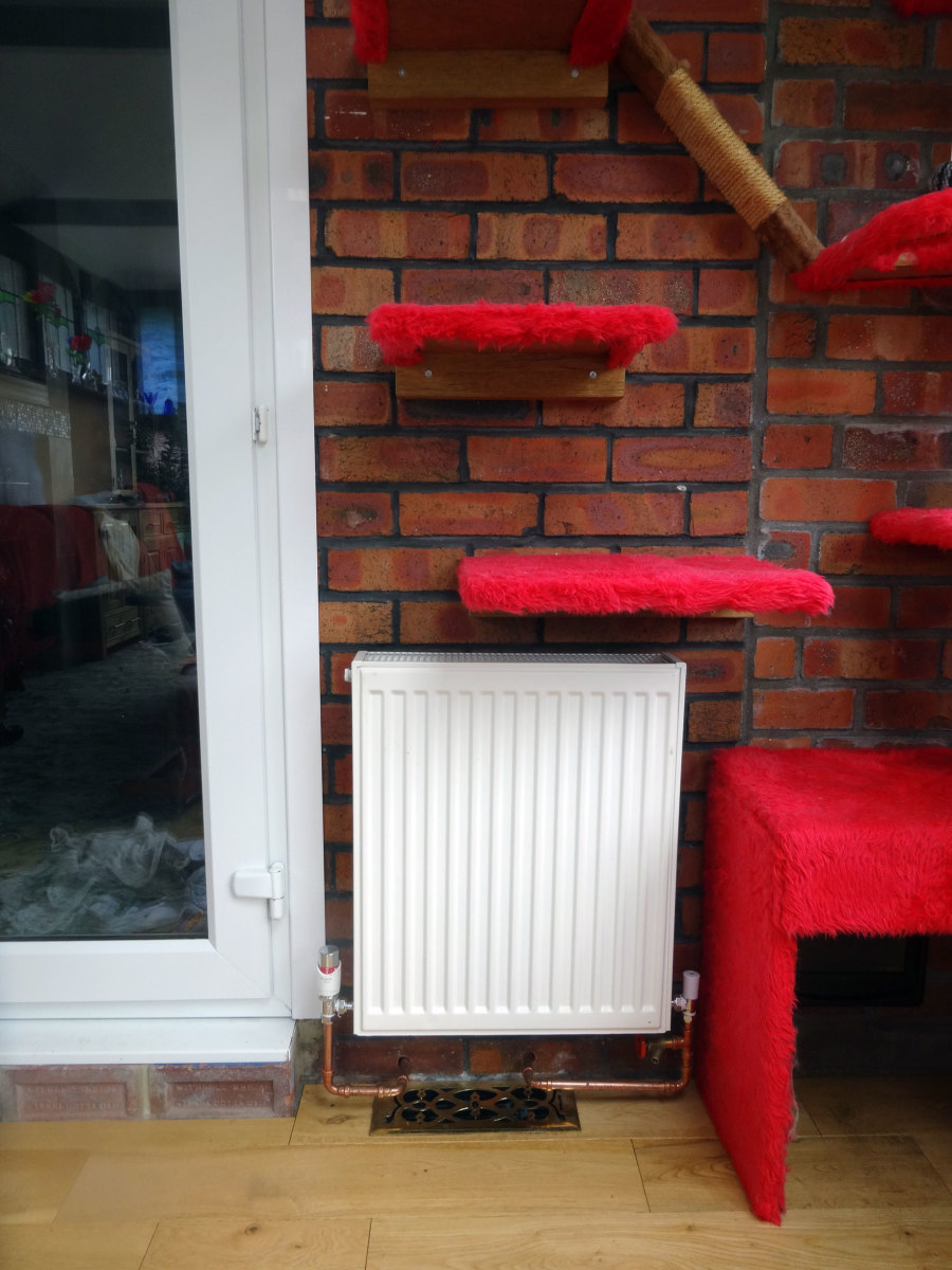 New radiator in conservatory, under the cat tree; to their delight