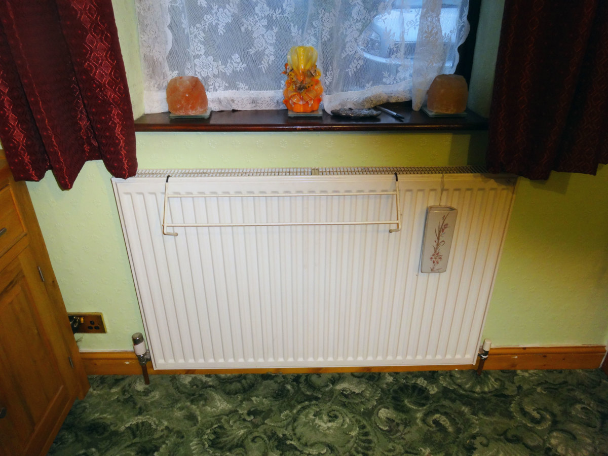 Original radiator from the sofa relocated to under the window