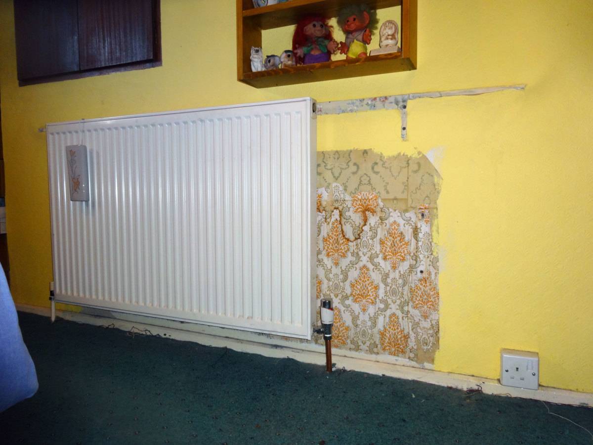 Smaller radiator installed in the main bedroom