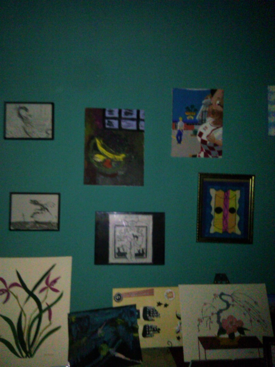 Some of the patient's paintings completed during their arts activities are set up for viewing in a section of the mental facility.