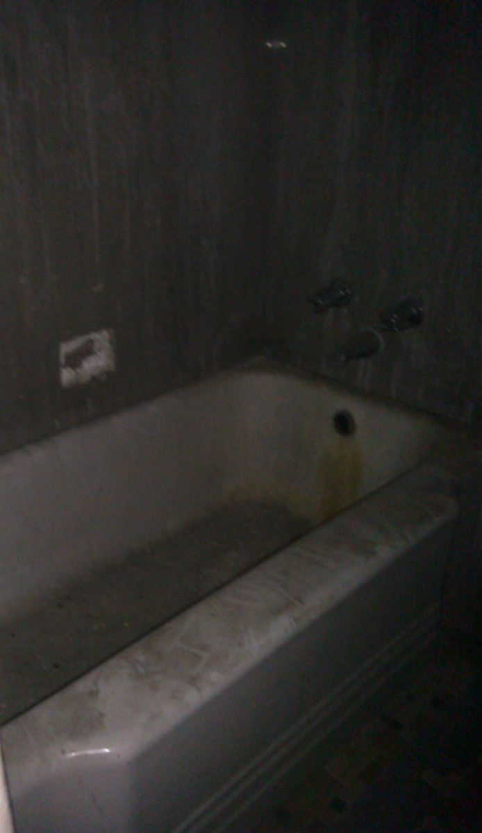Though I do not recall seeing it when I took the photo, there seems to be something scrawled in the dust on this tub, in the asylums shower facility.