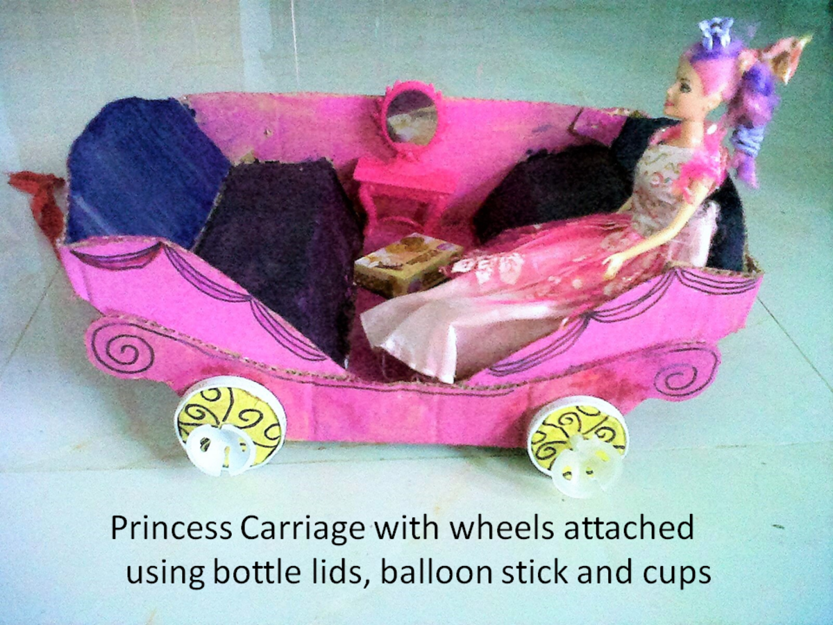 Princess Carriage after rework. Upgraded the wheels using bottle lids, balloon sticks and cups