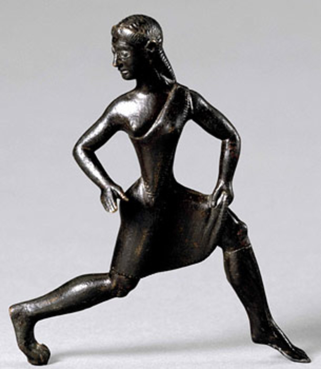 Bronze statuette of a girl wearing a short tunic. The single-shouldered garment, baring the right breast, was the characteristic dress of competitors in the Heraean Games.