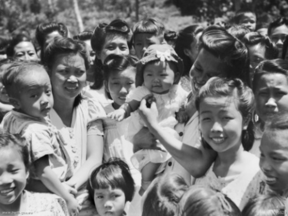 Rabaul area, New Britain. 1945-09-13. Chinese civilians, liberated from a Japanese POW camp. Many of the smaller children were born in the camp and some of the older ones had never seen white people before.