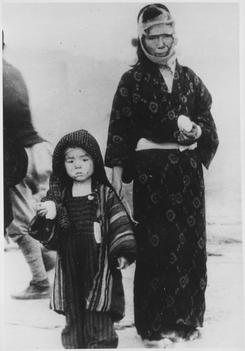 Before noon on August 10, 1945, a mother and her son have received a boiled rice ball from an emergency relief party. One mile southeast of Ground Zero, Nagasaki.