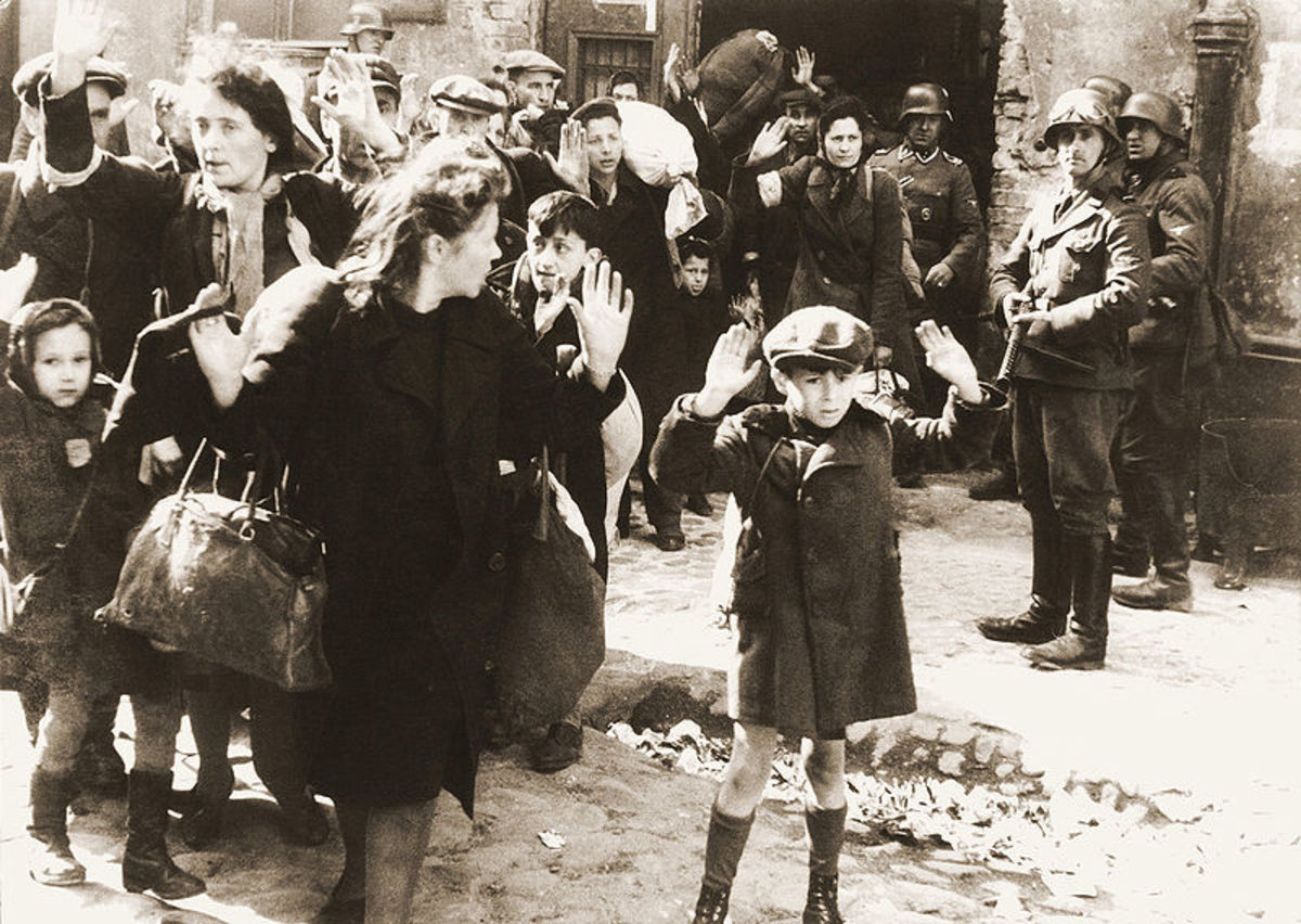 "Warsaw Ghetto Uprising - Photo from Jurgen Stroop report to Heinrich Himmler from May 1943. The original German caption reads: ""Forcibly pulled out of dug-outs"". One of the most famous pictures of World War II."
