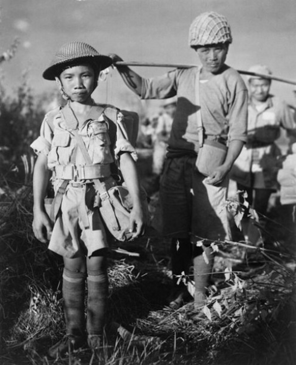 This Chinese soldier, age 10, is a member of an army division boarding a plane returning them to China from Burma, token by the allied forces, 1944.