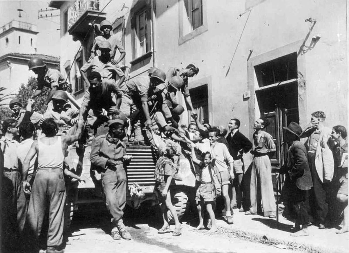 Brazilian soldiers (Brazilian Expeditionary Force or BEF), greet Italian civilians in the city of Massarosa, September 1944.