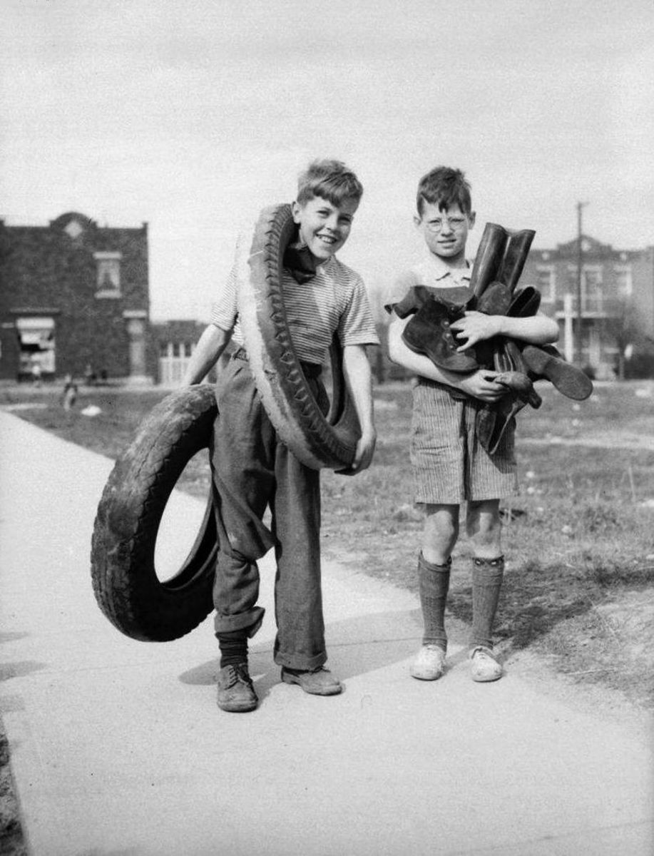 Two boys in the Rosemont neighbourhood gather rubber for wartime salvage. Montreal, Canada. April 1942
