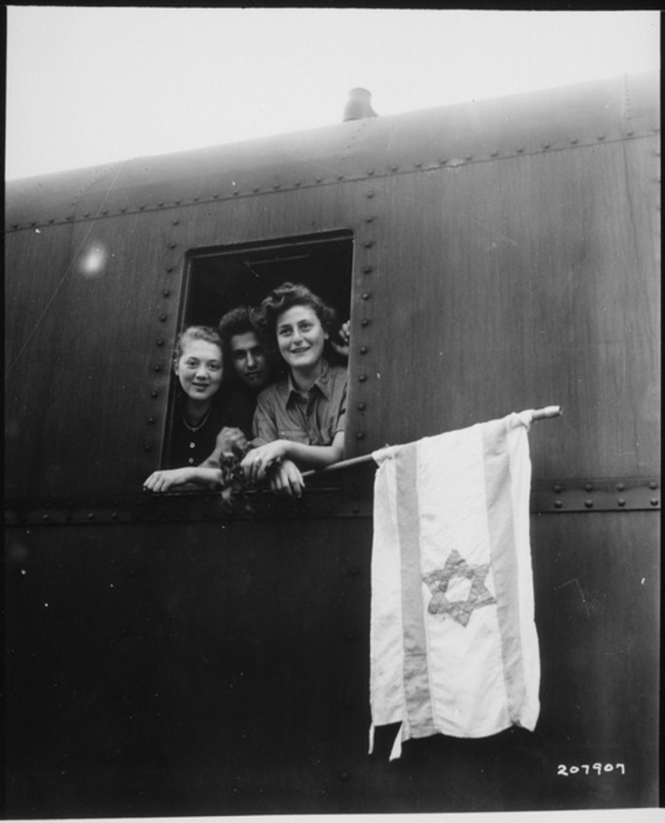 These Jewish children are on their way to Palestine after having been released from the Buchenwald Concentration Camp. The girl on the left is from Poland, the boy in the center from Latvia, and the girl on right from Hungary.