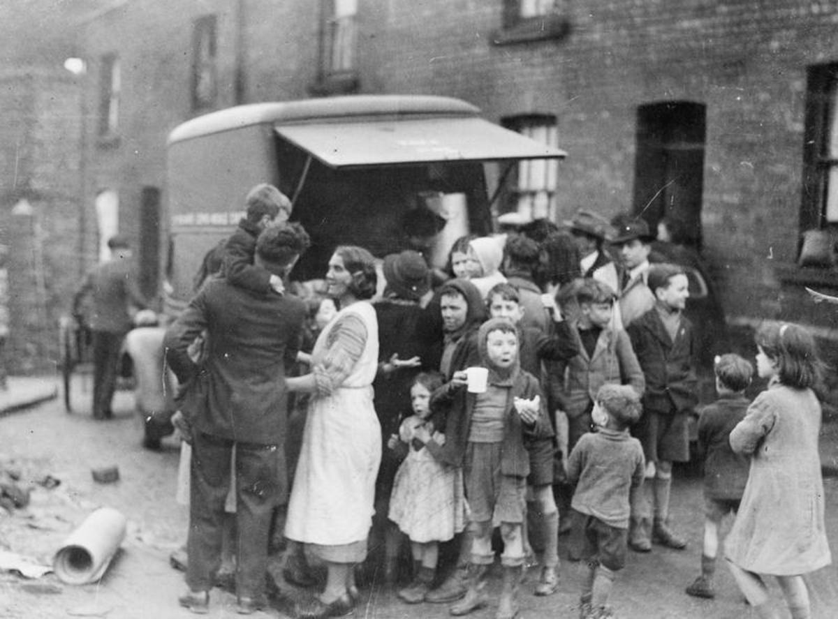 Tea and sandwiches from a mobile canteen after a night's bombing. Between 1940 and 1943 Swansea was the target of 44 raids with 340 killed and thousands more injured.